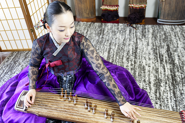 Eun-Sun Jung plays the gayageum, an ancient 12-string Korean instrument. Photos by Martin Boling