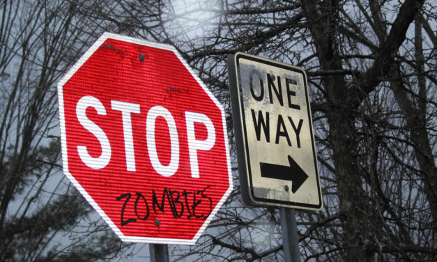 Vandalized Stop Signs With Many Messages
