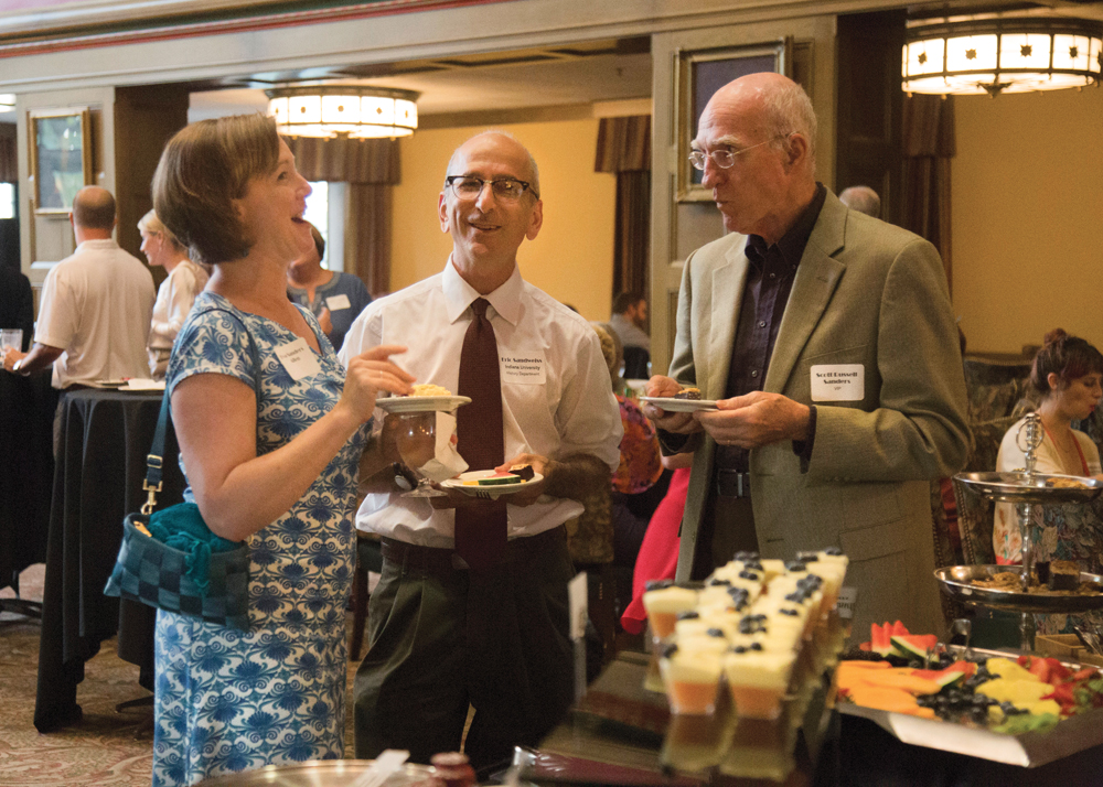 Eric Sandweiss, chair of the IU History Department (center), chats with (l-r) Eva Allen, assistant director of the IU Environmental Resilience Institute, and author Scott Russell Sanders.
