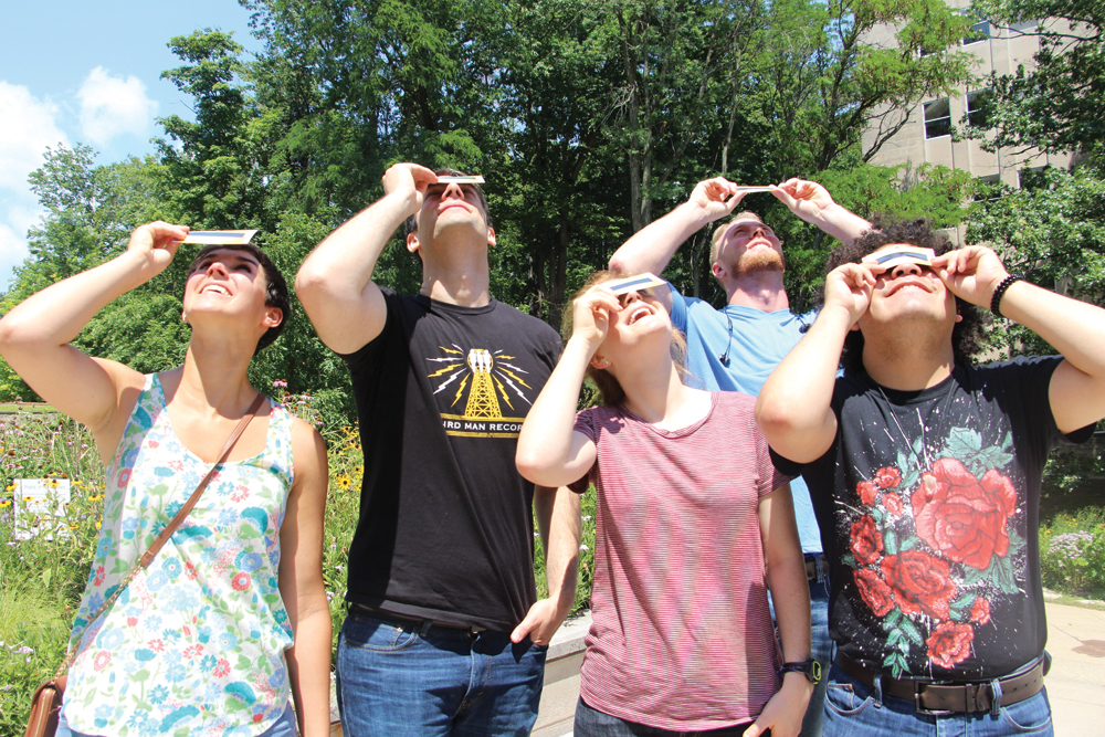 Indiana University students practice safe solar viewing with IU Solar Eclipse Cards in preparation for the August eclipse. (l-r) Kate Hummels, Chris Puccis, Madeline Danforth, Nicholas Neidig, and Mannuel Arriaga. Photo by Alexandria Eady, IU Office of Science Outreach media intern
