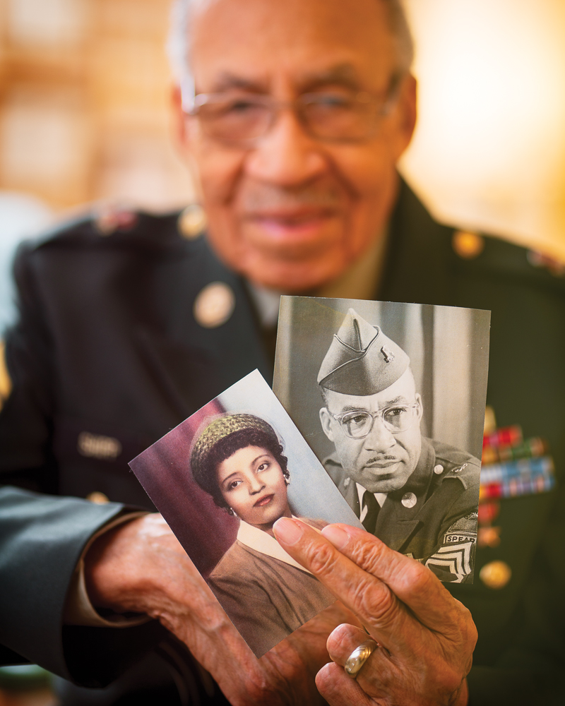 Gene holds photos of his first wife, Doris, and himself, back in the day.